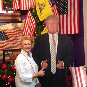 Annabelle, of Annabelle's Interiors with the Shoppe's President Trump cardboard standee,